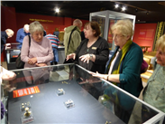 Our inspiring guide, Cathy Shingler, with some of the Friends, examine part of the exquisite C7-9th Anglo-Saxon Staffordshire Hoard.