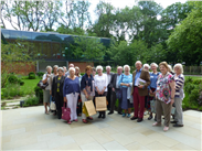 Group photo of the Williamson Friends, after their day at the Whitworth Art Gallery. See the beautiful Art Garden in the background.