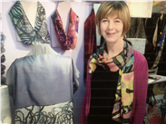Joanne in her studio wearing the Whitworth Scarf in the summer colours!